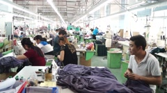 Garment factory workers are the garment processing, in Shenzhen, China - stock footage
