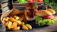 Delicious takeaway burger with cold drink and fries - stock footage