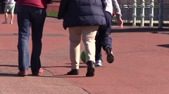 People walking and cycling in promenade Stock Footage