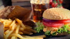 Fresh takeaway hamburger with cold drink and fries - stock footage