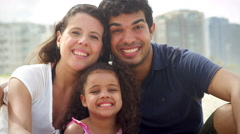 Brazilian family smiles on a beach in Brazil Stock Footage