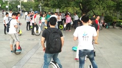 To ride a unicycle, in Shenzhen, China Stock Footage