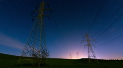 Electricity,high voltage pylons,power transmission lines night stars timelapse Stock Footage