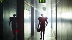 4K American football player walks alone through stadium tunnel - stock footage