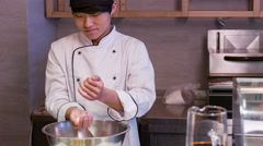 Asian chef standing in kitchen of sushi bar pouring rice Stock Footage