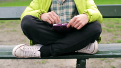 Man sitting on the bench and using tablet Stock Footage