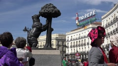ULTRA HD 4K Tourist people take photo Bear Madrono Madrid Puerta del Sol daytime Stock Footage