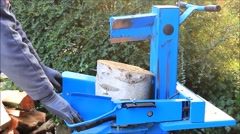 Worker with wood splitter in action, hydraulic, electric, firewood Stock Footage