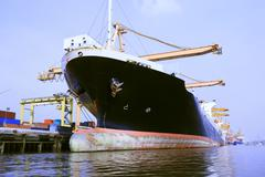 Commercial ship in port loading container Stock Photos