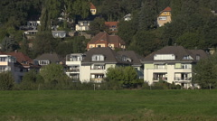 Housing development in Germany between trees and a grassy meadow Stock Footage