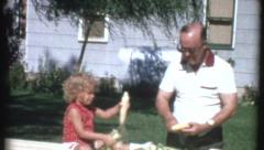 Grandfather and Grandfather Work Together 70s Vintage Retro Film Home Movie 8240 Stock Footage