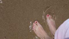 Ladies feet in water. Stock Footage