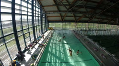 View of Utrina indoor swimming pool during lessons. Stock Footage