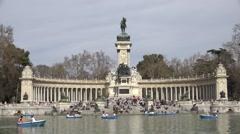 ULTRA HD 4K Tourist people enjoy Alfonso Monument Retiro Park Madrid icon place  Stock Footage