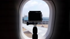 Camera Filming from Illuminator Window of Airplane Stock Footage