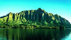 Sunrise over Steep Tropical Mountains on Calm Lake in Hawai'i in 4K (Timelapse) Stock Footage