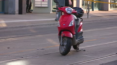 Police investigate accident scene involving e-bike moped on city street Stock Footage