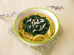 Gluten free spaghetti with spinach - stock photo