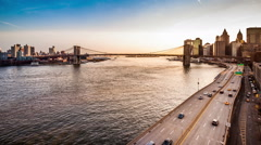 Brooklyn Bridge, boats sailing East River and FDR drive traffic Stock Footage
