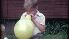 Boy Children Blowing Up Balloons Kids 1960s Vintage Retro Film Home Movie 8272 Stock Footage