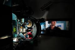 35 mm movie cinema projector machine with out of focus cinema screen Kuvituskuvat