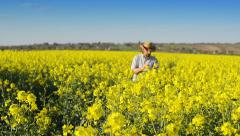 Farmer Standing in Oilseed Rapeseed Cultivated Agricultural Field Stock Footage