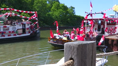 Canada day patriotic crowds with boats and Canadian flags in Port Dover - stock footage