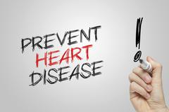 Hand writing  prevent heart disease Stock Photos