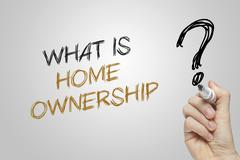 Hand writing what is home ownership - stock photo
