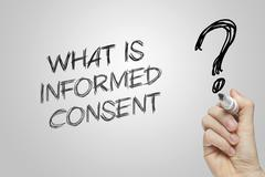 Hand writing what is informed consent - stock photo
