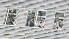 Fans of air conditioning system rotating on roof of modern building. Stock Footage