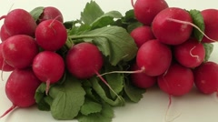 Radishes on a white background Stock Footage