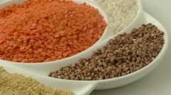 Collection of various legumes on a round white plate Stock Footage