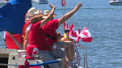Stock Video Footage of Canada day patriotic crowds with boats and Canadian flags in Port Dover