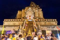 Crowd of people worshiping at  Wat Chedi Luang - stock photo