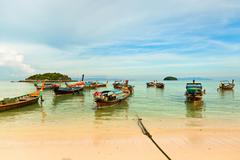 Traditional thai boats on the beach, Koh Lipe, Thailand. Stock Photos