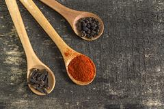 Spices in wooden spoo - stock photo