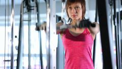 Woman doing exercise with at the gym Stock Footage
