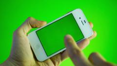 Using smart phone on green screen with various hand gestures Stock Footage