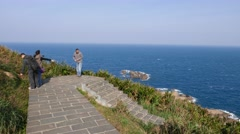 Beautiful cliff and stairs without railing, tourists taking pictures Stock Footage