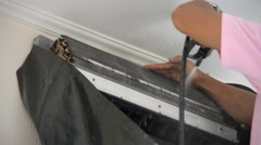 Stock Video Footage of Repairman fixing and cleaning air conditioner unit