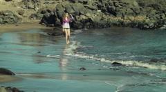 beatiful Female Model walks along the seashore - stock footage