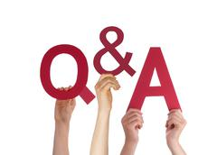 Hands Holding Red Word Questions And Answers Stock Photos