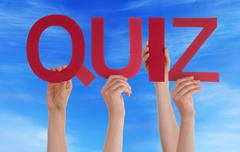 Many People Hands Holding Red Straight Word Quiz Blue Sky - stock photo