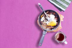 Sunny Side up Omelette on Violet Color Table Cloth with a Mason Hot Tea - stock photo