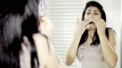 Woman removing mustache shouting for pain Stock Footage