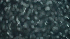 Snowstorm. Isolated snow falling on black background Stock Footage