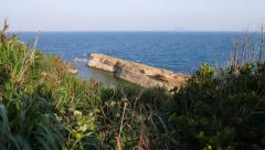 Cliff, half sunken rock in deep waters, Yehliu Geopark Stock Footage