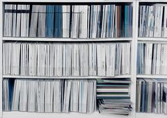 Bookcase with publications Stock Photos