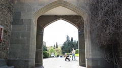 View through a medieval stone arch at the park. Stock Footage